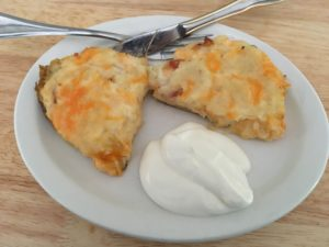 Stuffed Baked Potatoes Served up Hot with a scoop of sour cream